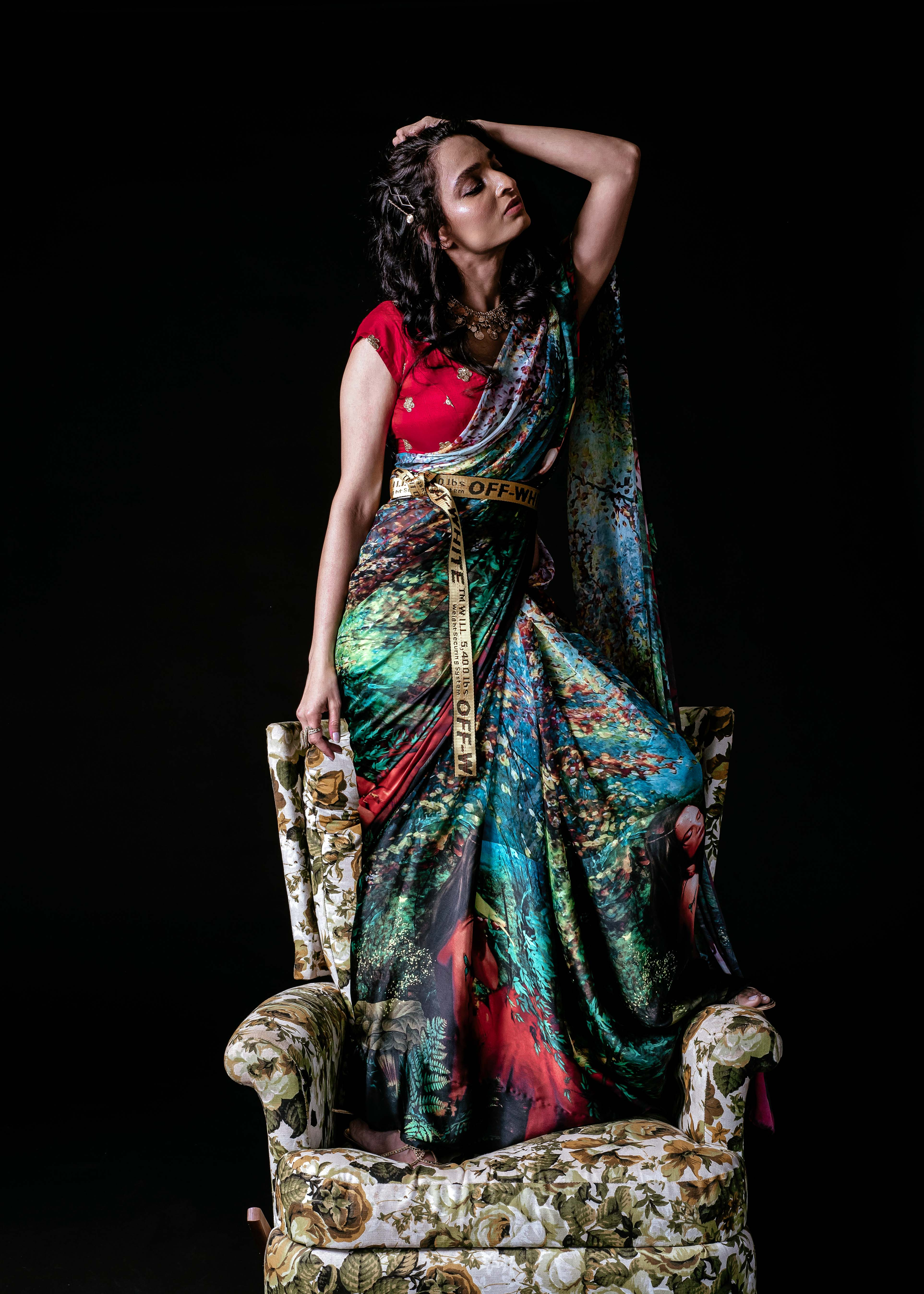 Green Saree sitting on floral chair