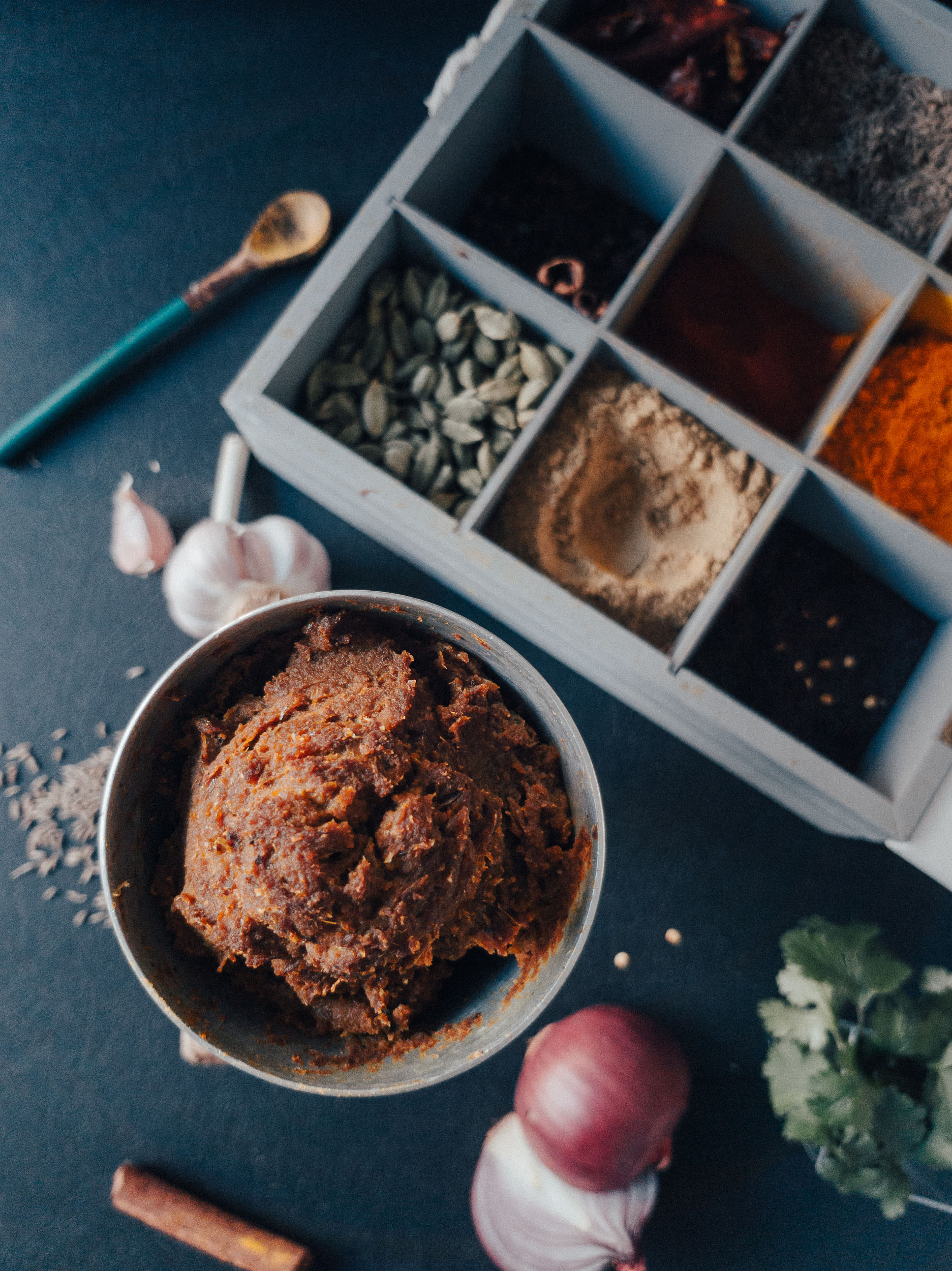 flatlay of ingredients for Bhoona masala recipe for Indian gravies including indian spices